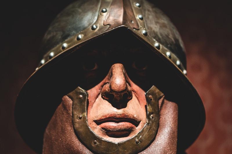 brown and gray metal mask