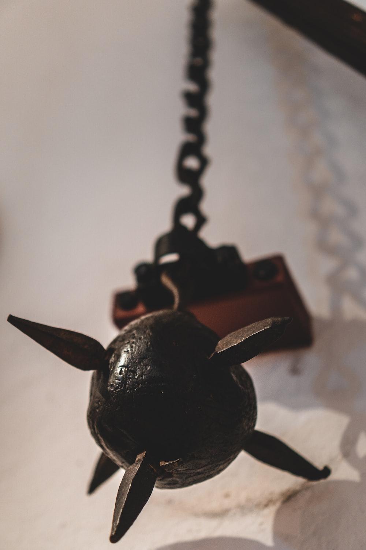 black dragon pendant on white textile