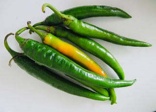 green chili on white surface