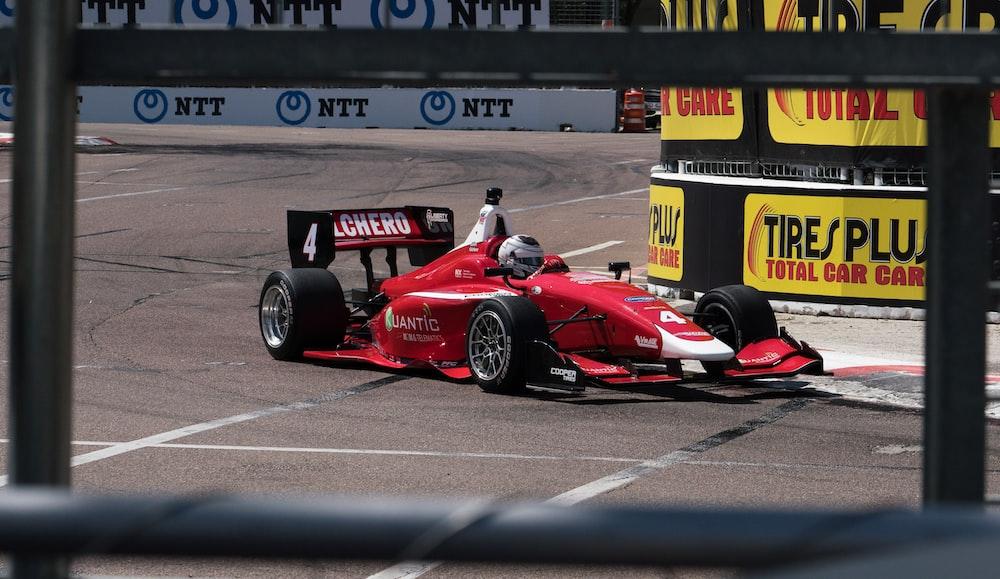 red ferrari f 1 on race track