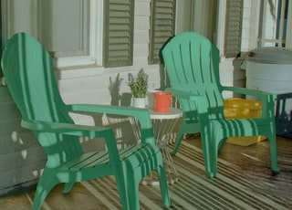 blue wooden armchair beside green potted plant