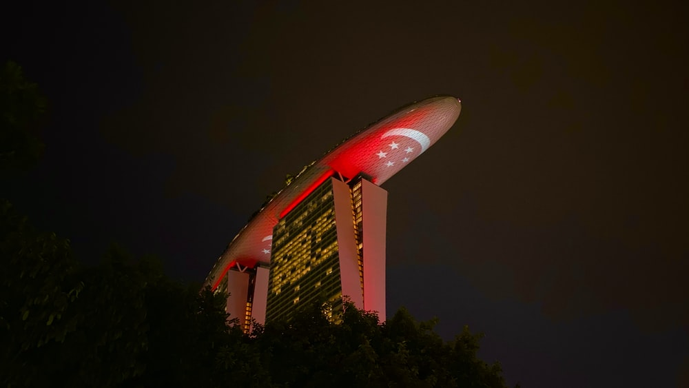 red and white space ship during night time