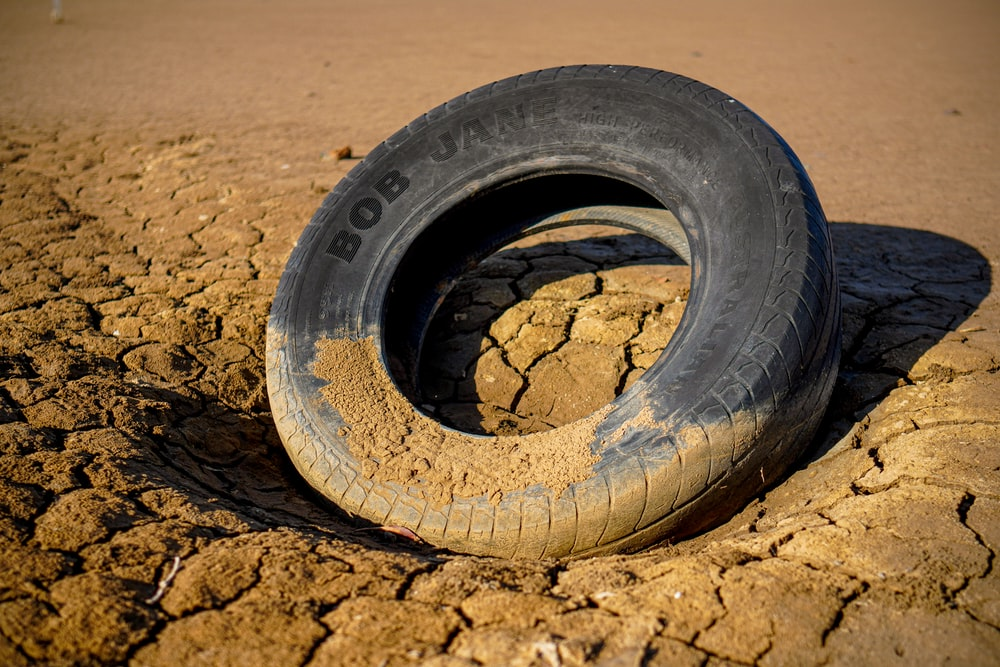 black tire on brown sand
