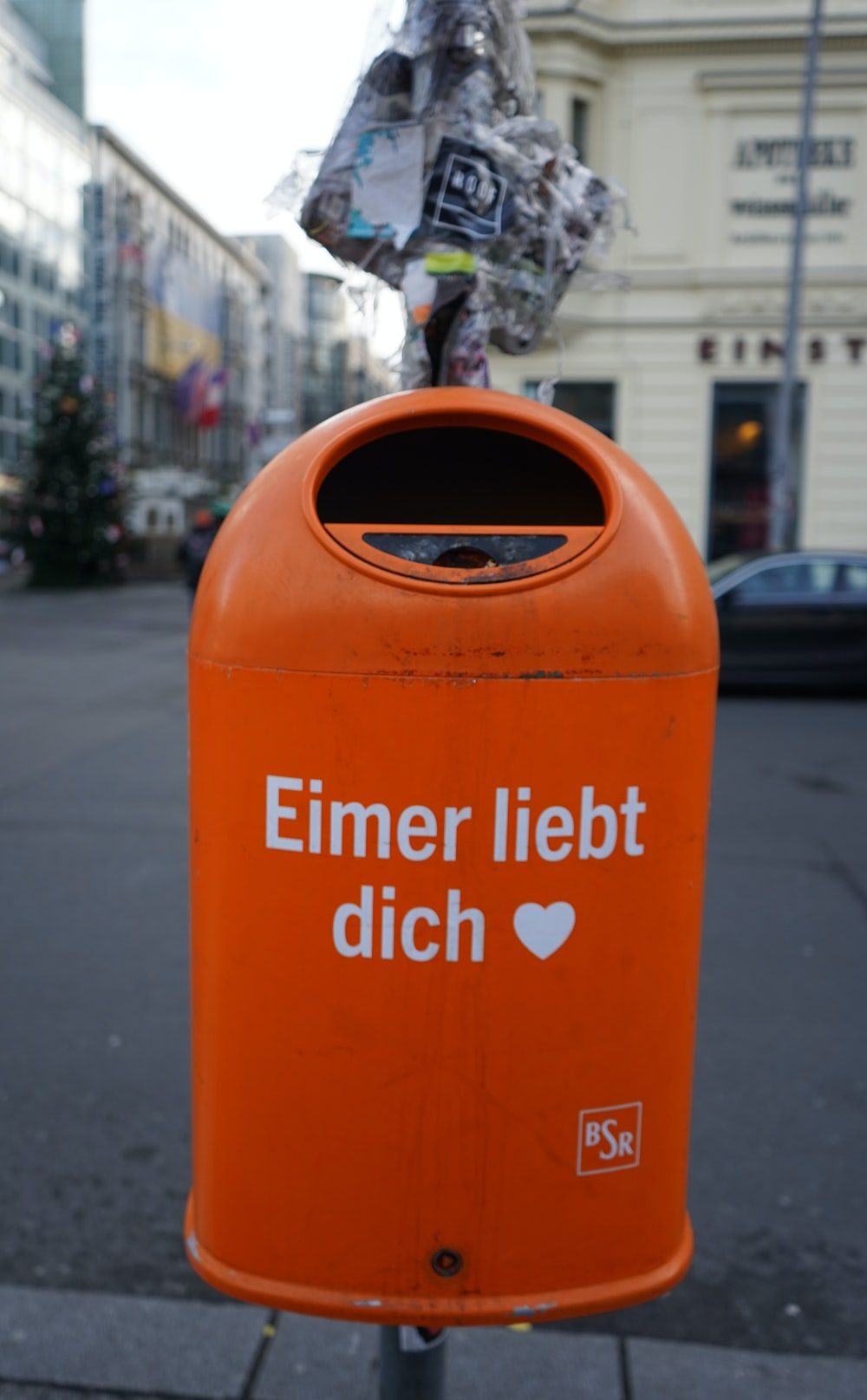 orange and white trash bin