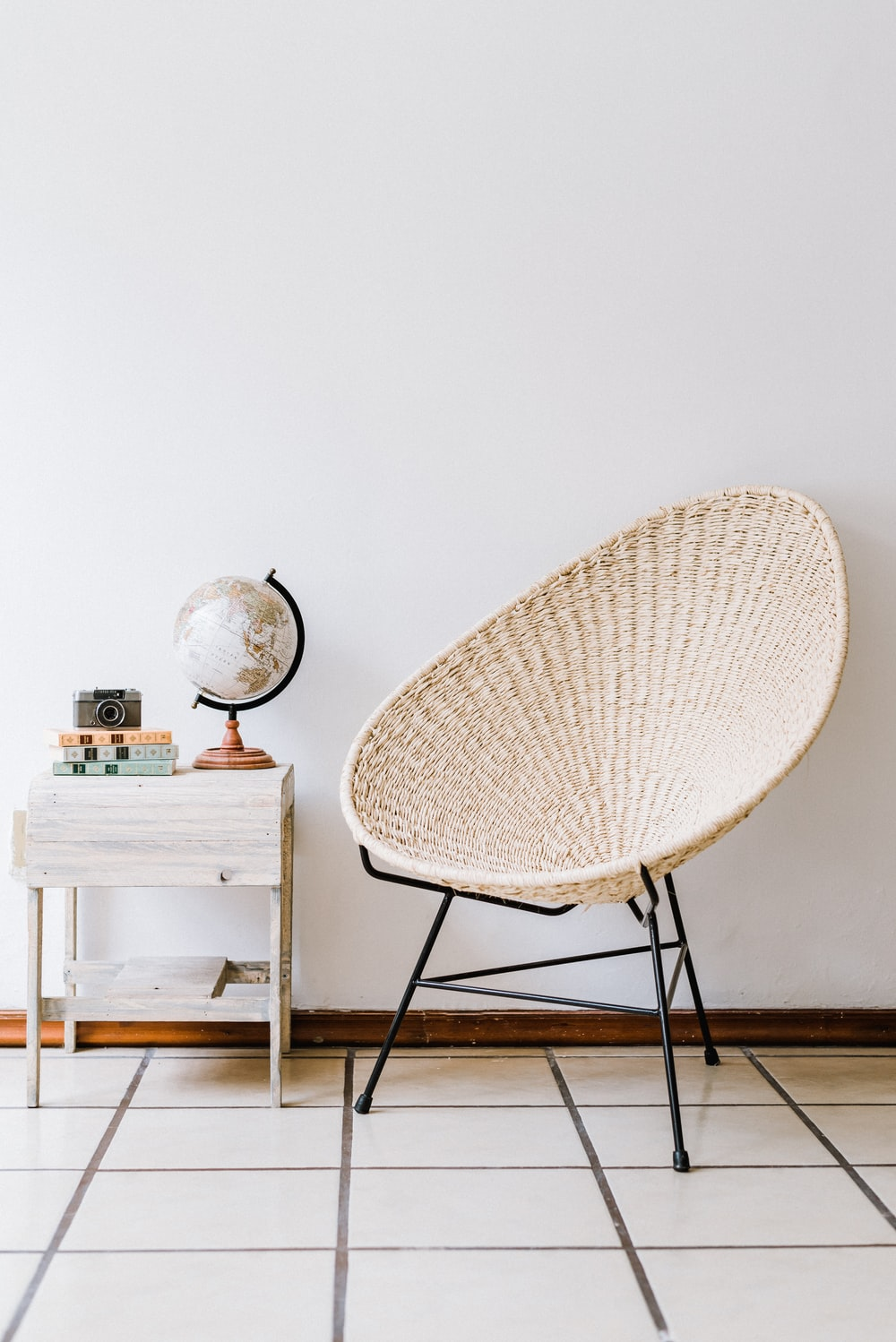 white and black chair beside white table