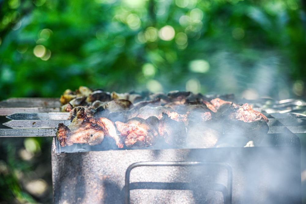grilled meat on gray metal grill