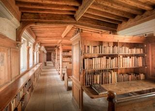 brown wooden book shelves on brown wooden floor