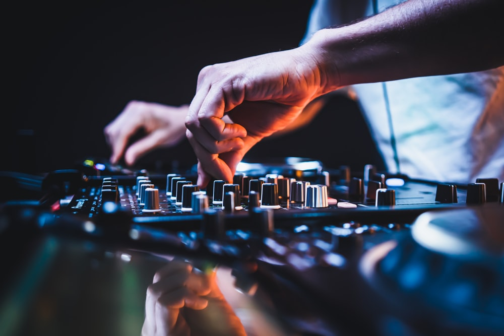 person playing audio mixer in close up photography