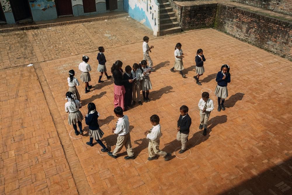people walking on brown concrete floor during daytime