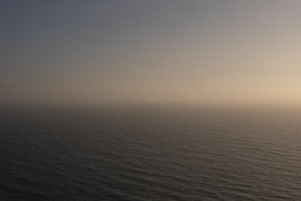 body of water under gray sky