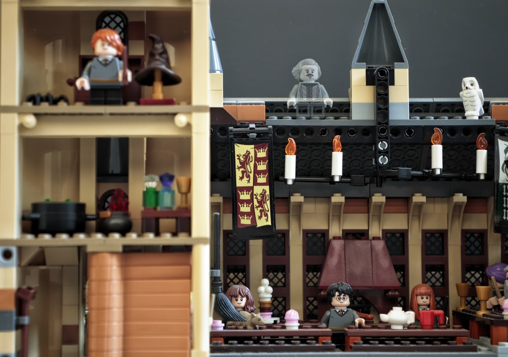 lego toys on brown wooden shelf