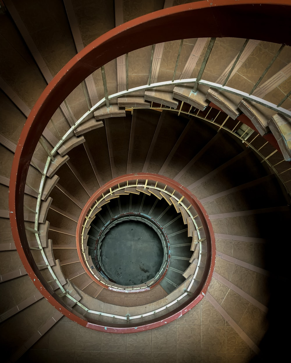spiral staircase with white metal railings