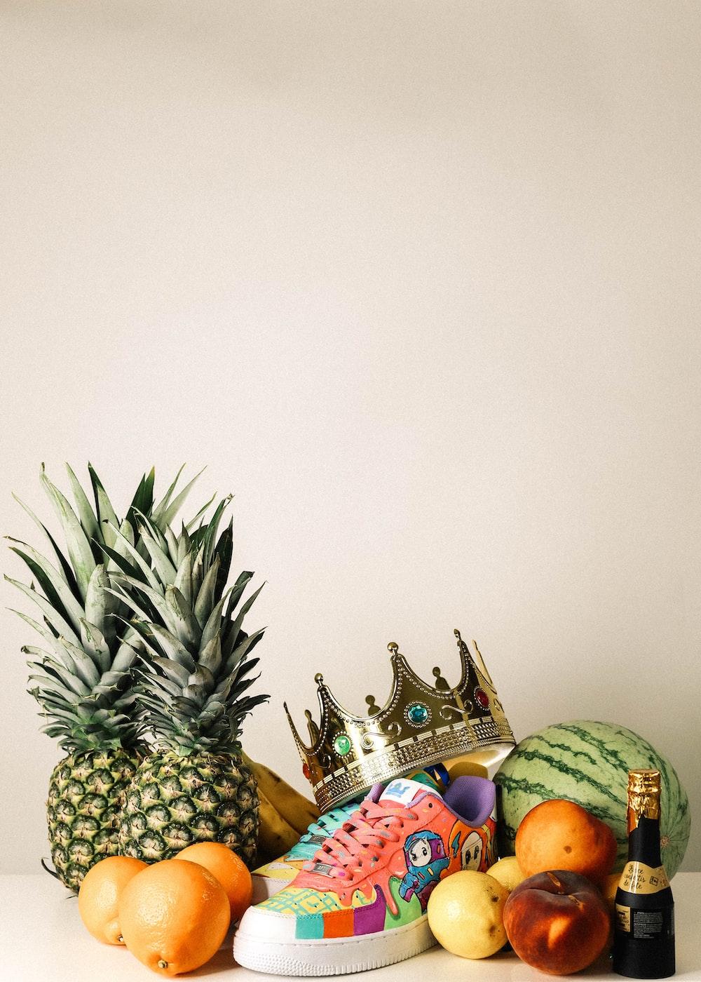 pineapple fruit beside green pineapple fruit
