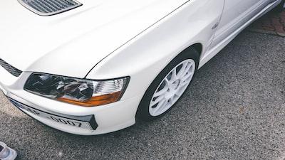 white car on gray asphalt road mitsubishi zoom background