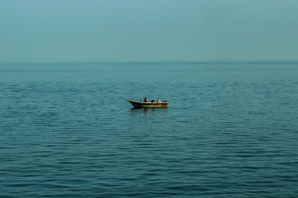 brown boat on sea during daytime