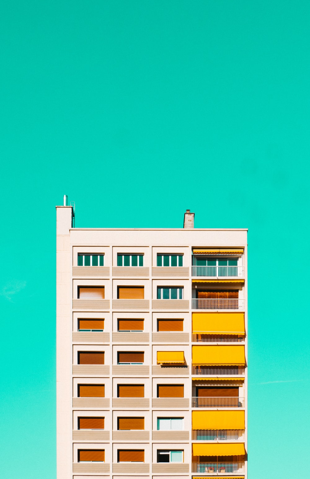 white and yellow concrete building under blue sky during daytime