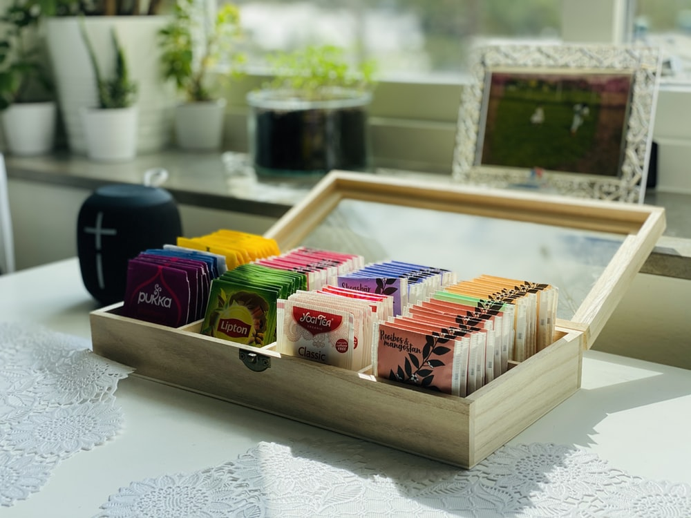 brown wooden box with assorted color pencils