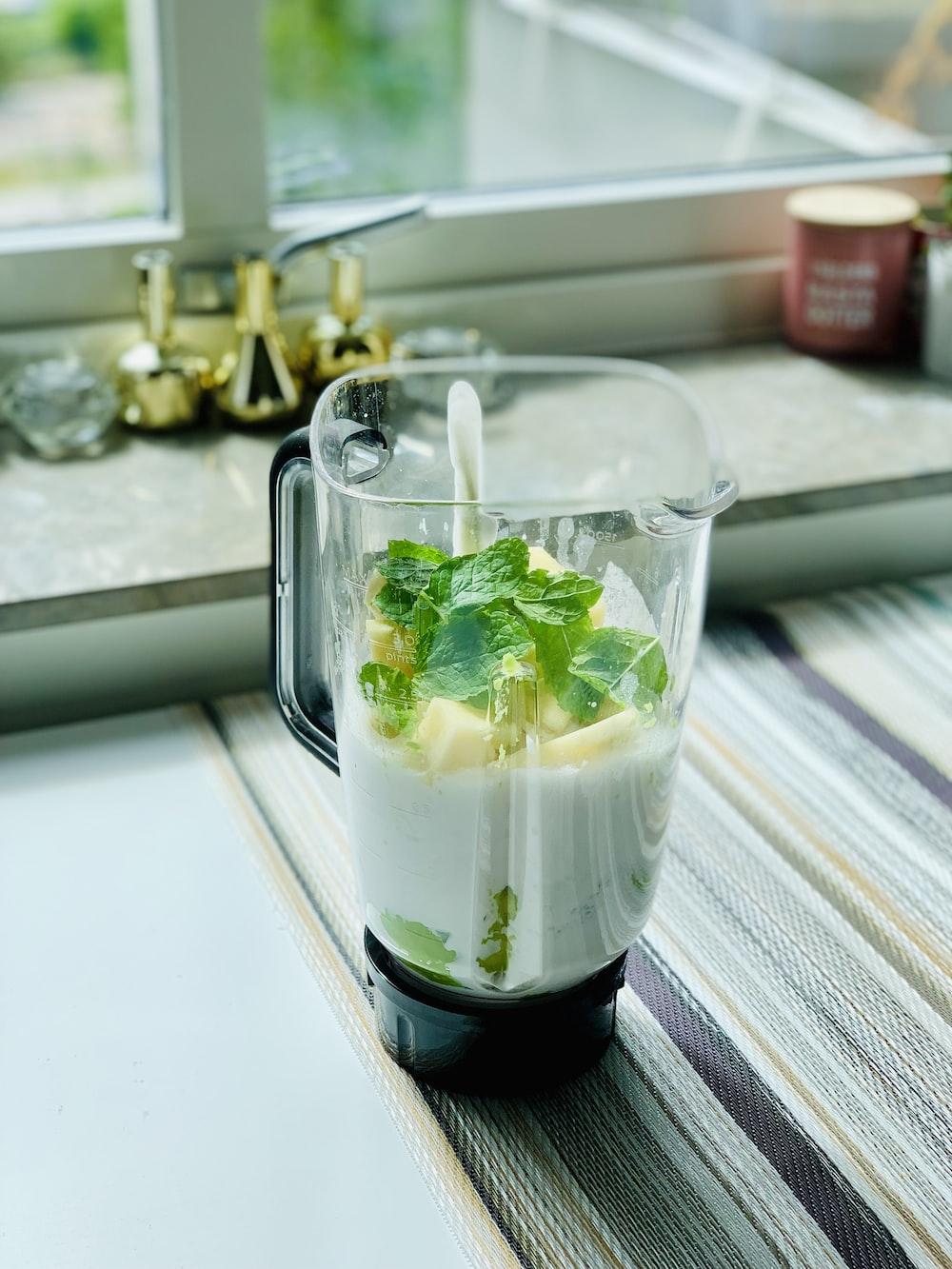 clear glass mug with white liquid