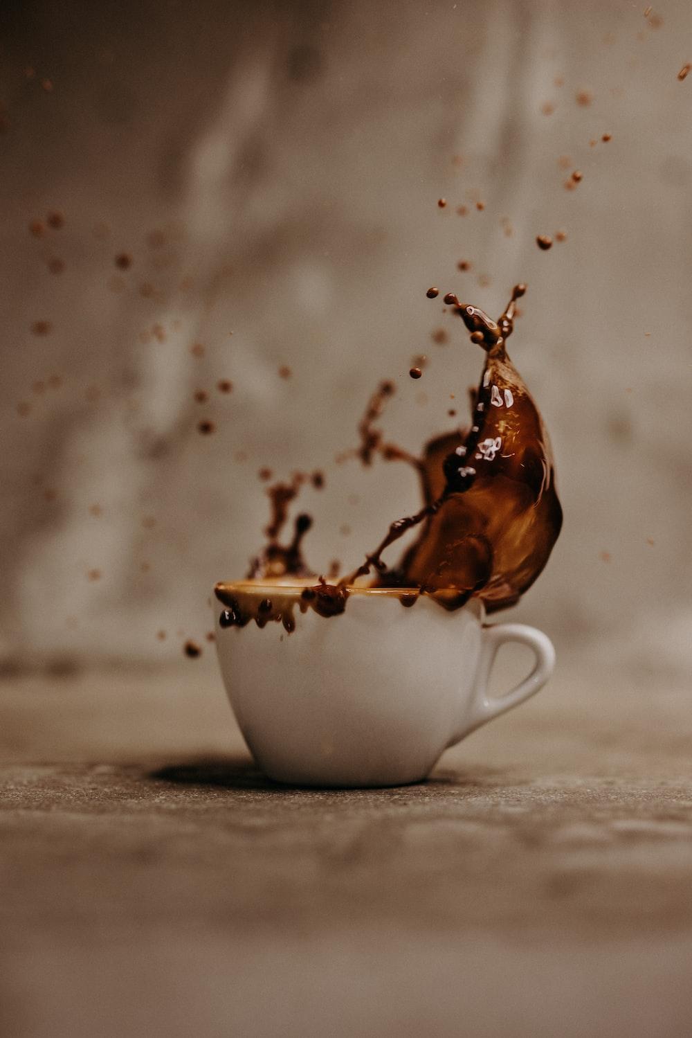 brown liquid in white ceramic teacup