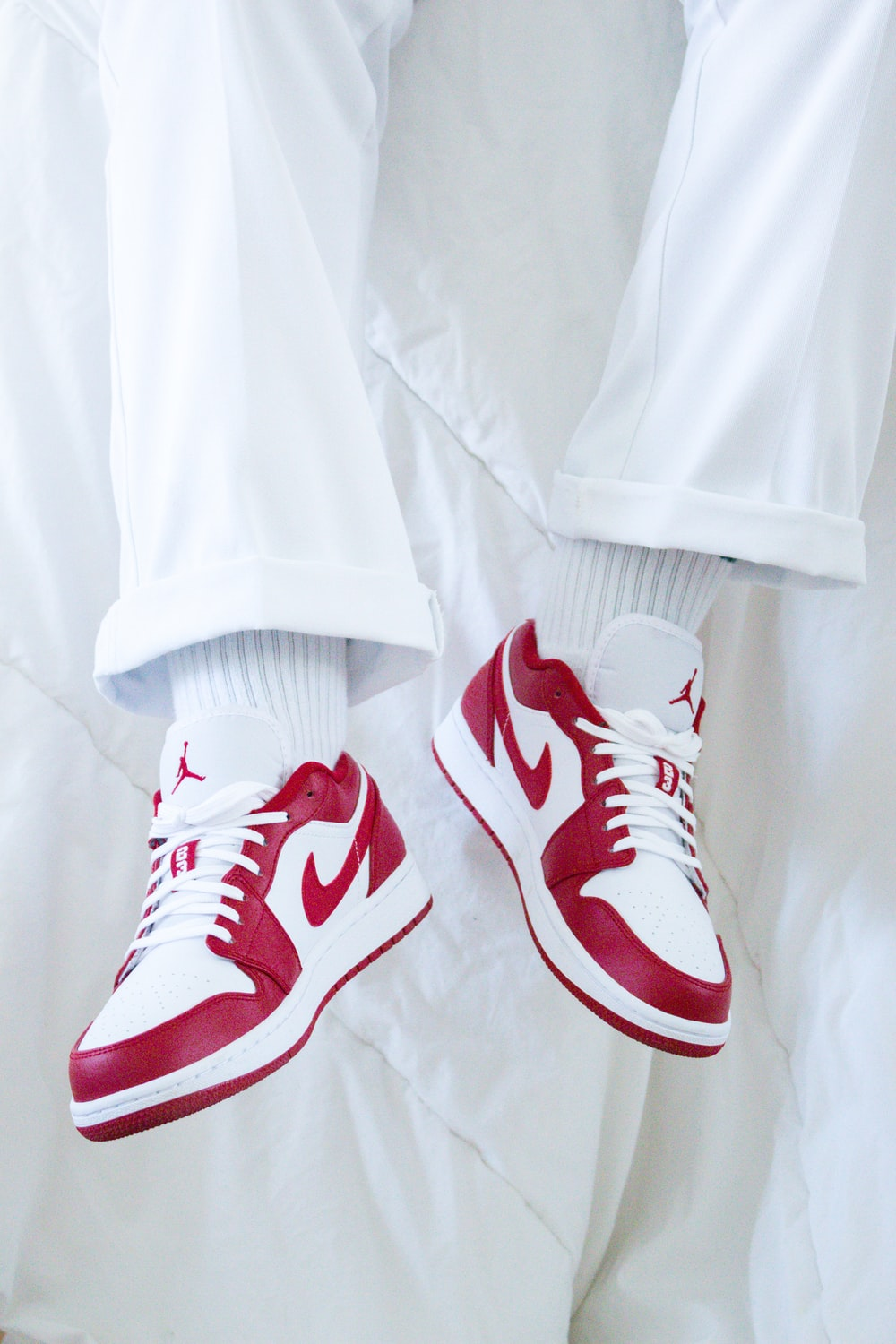red and white nike sneakers