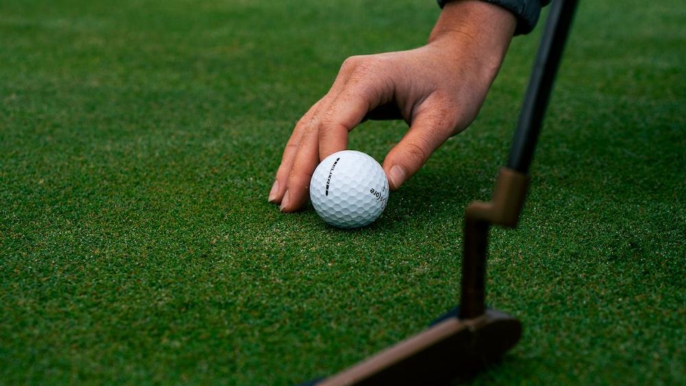 white golf ball on green grass field