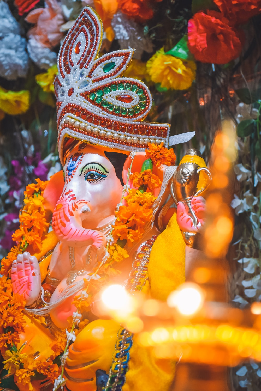 hindu deity figurine with string lights