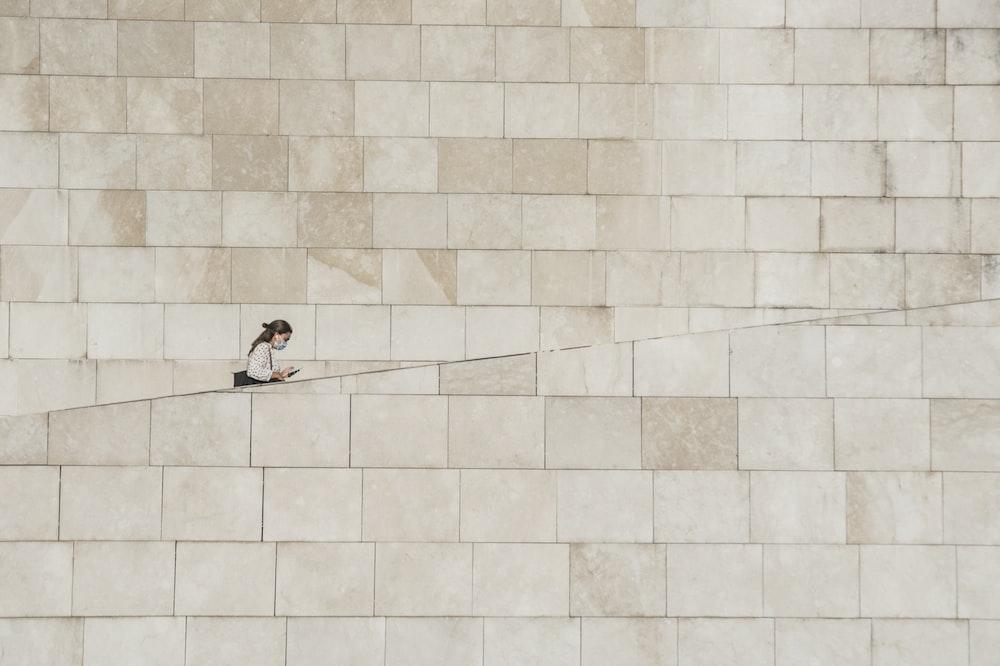 2 person lying on white ceramic tiles