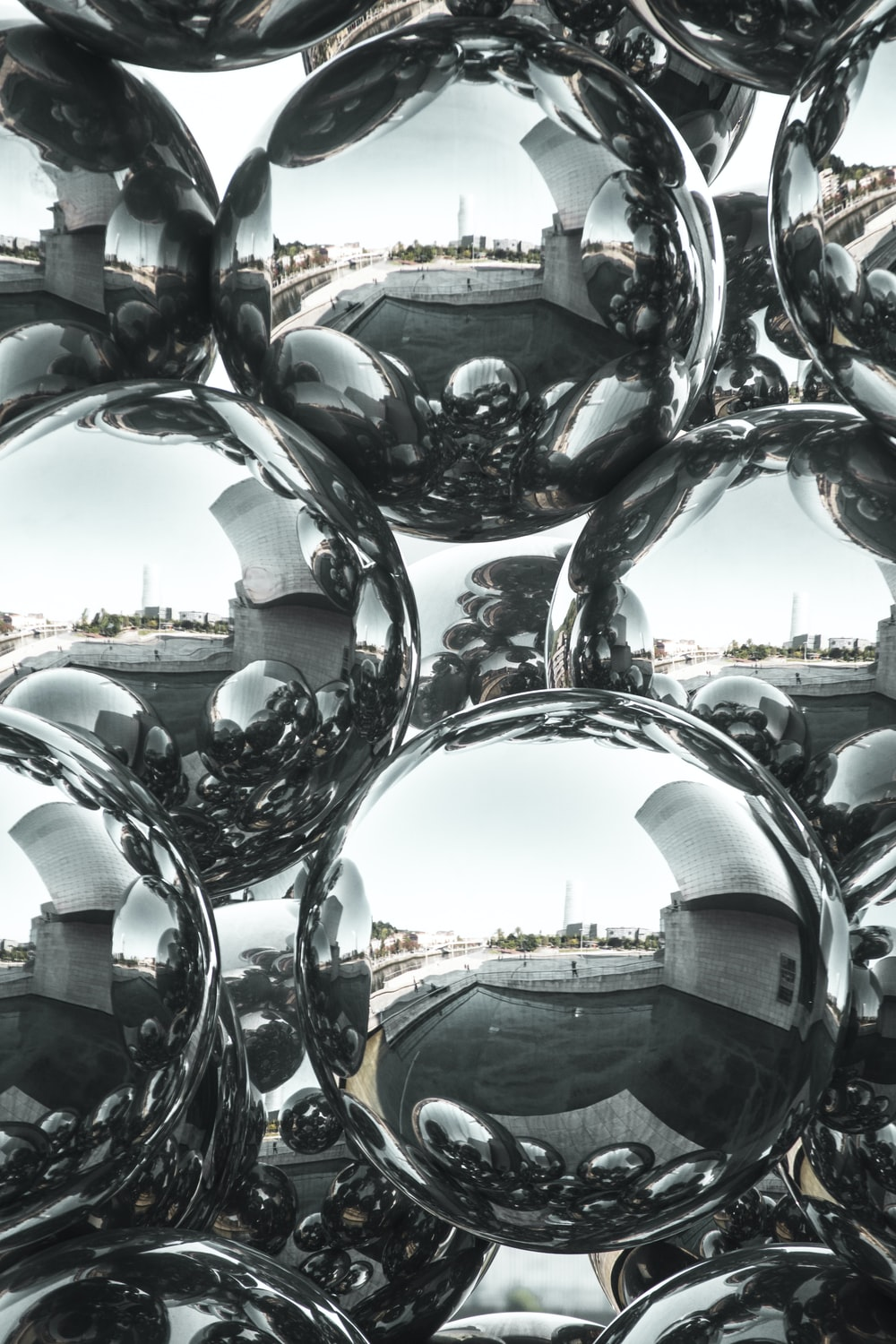 silver round ball statue during daytime