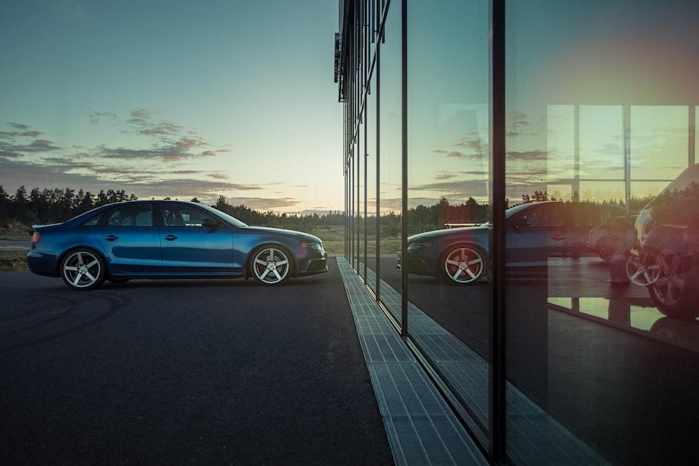 blue sedan sitting at dealership