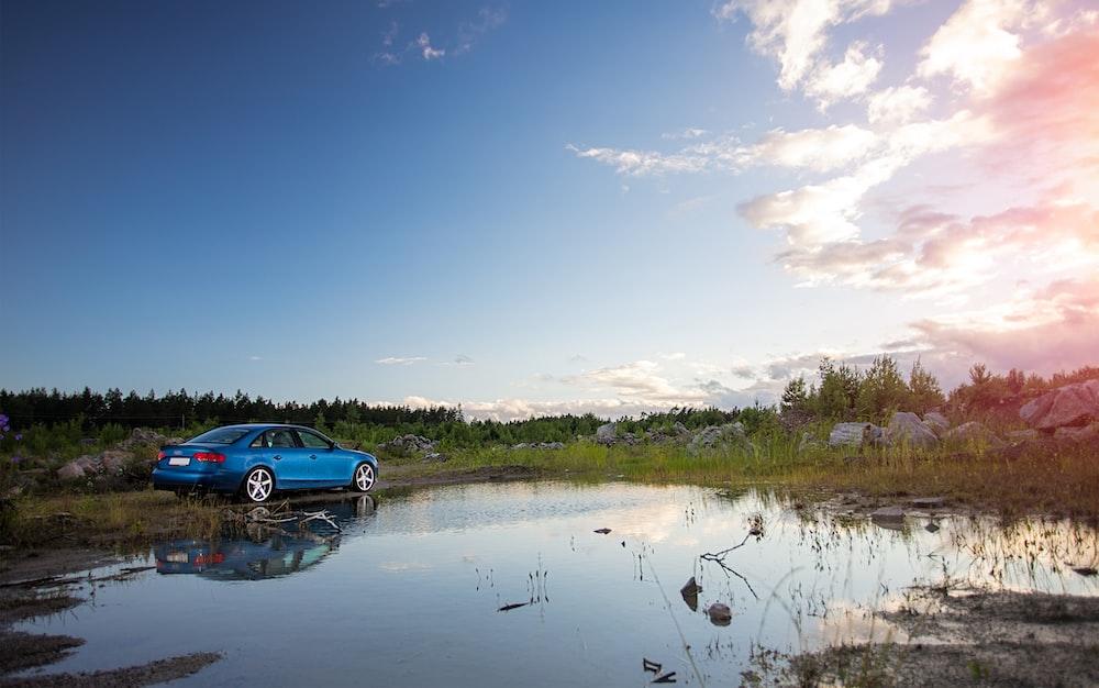 blue car on river during daytime