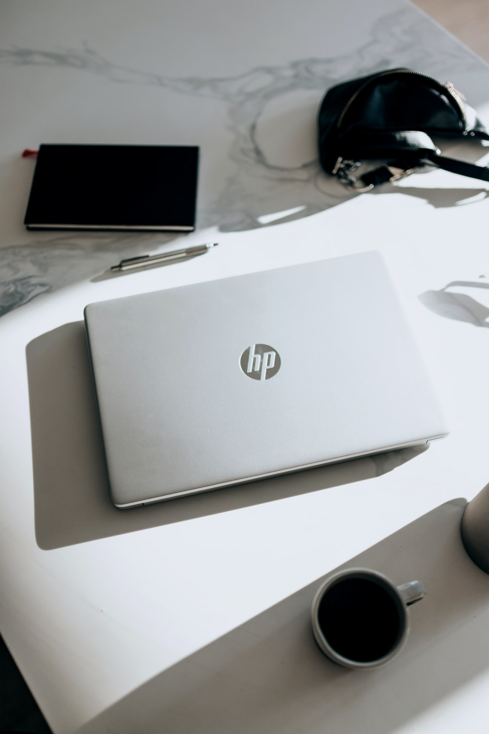 silver hp laptop computer on white table