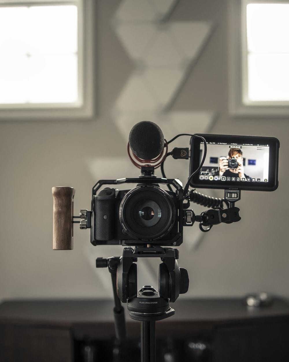 black camera on black tripod