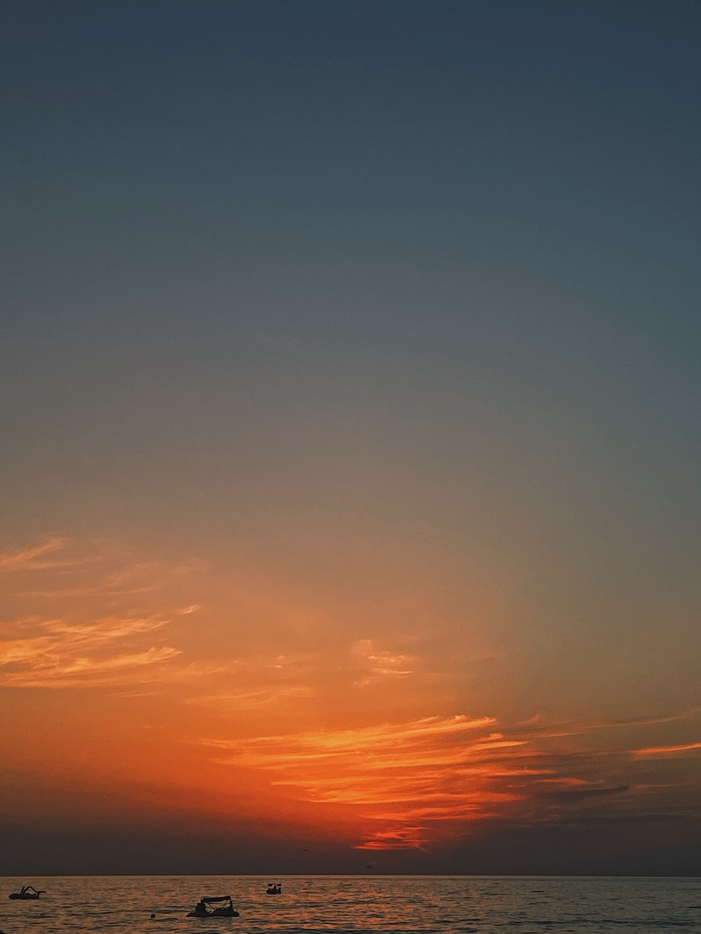 orange and blue sky during sunset