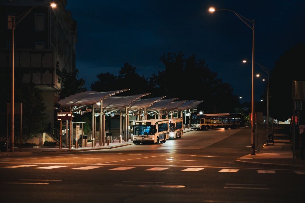 white and brown tram on street during night time