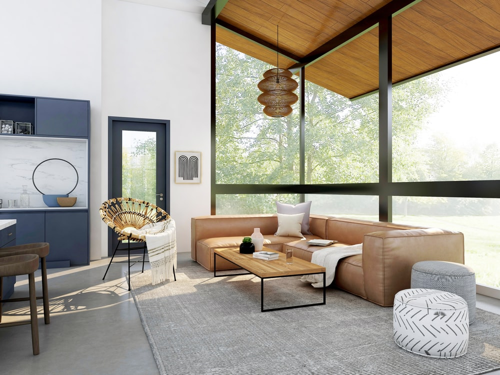living room with brown sofa and glass window