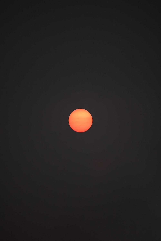 orange round light on black background