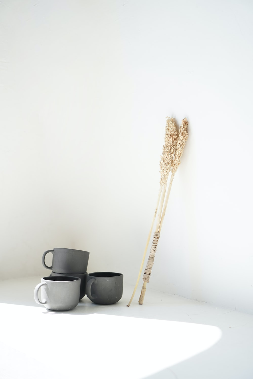 brown wooden stick on black ceramic mug
