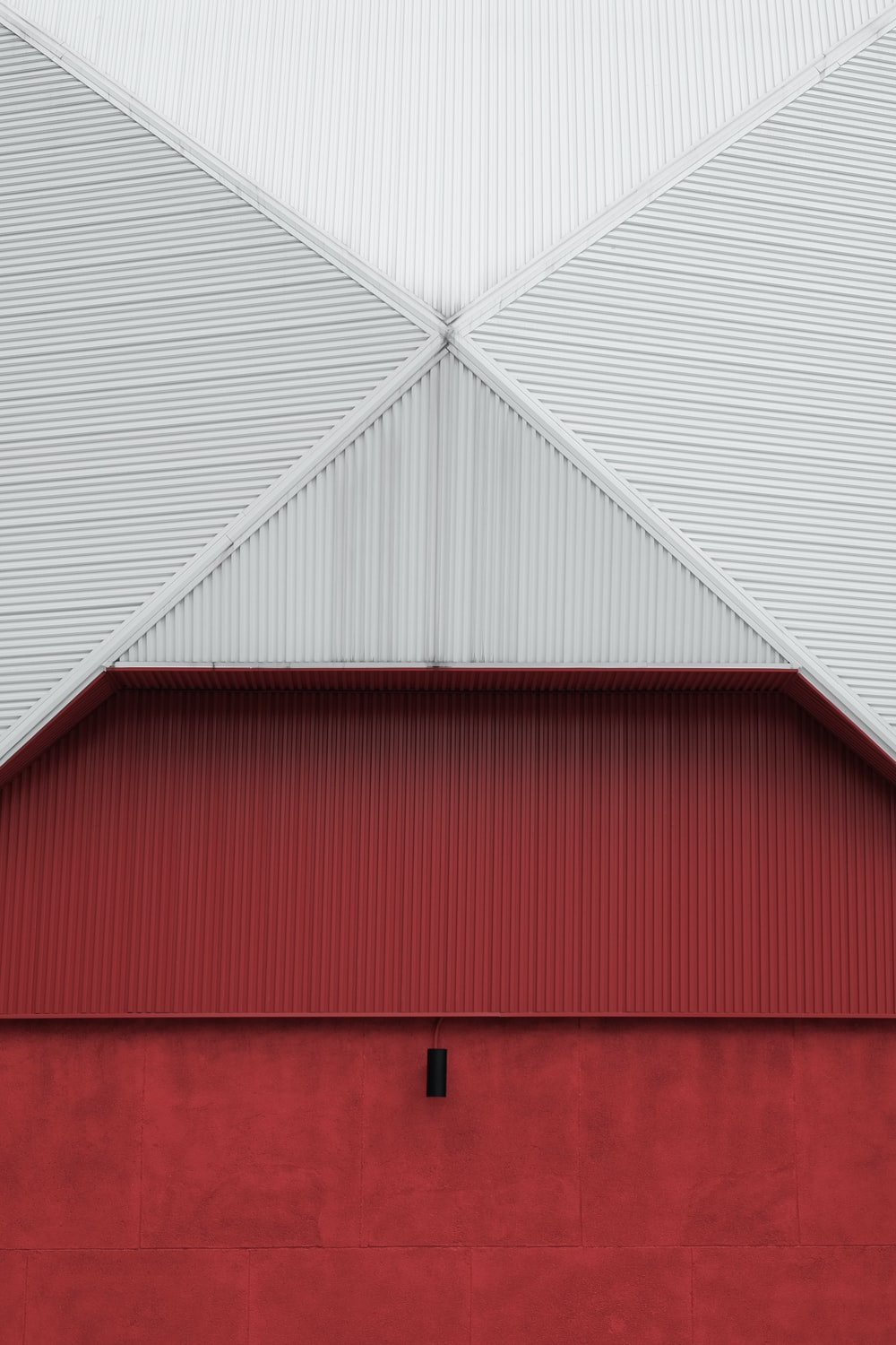 red and white wooden barn
