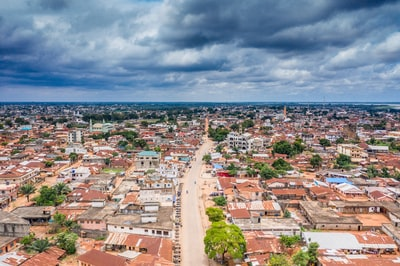 aerial view of city buildings under cloudy sky during daytime benin teams background