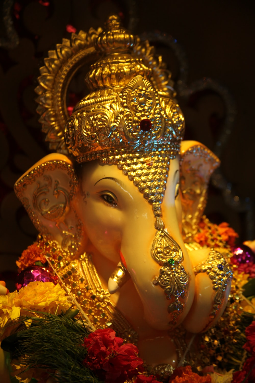 gold and silver hindu deity figurine