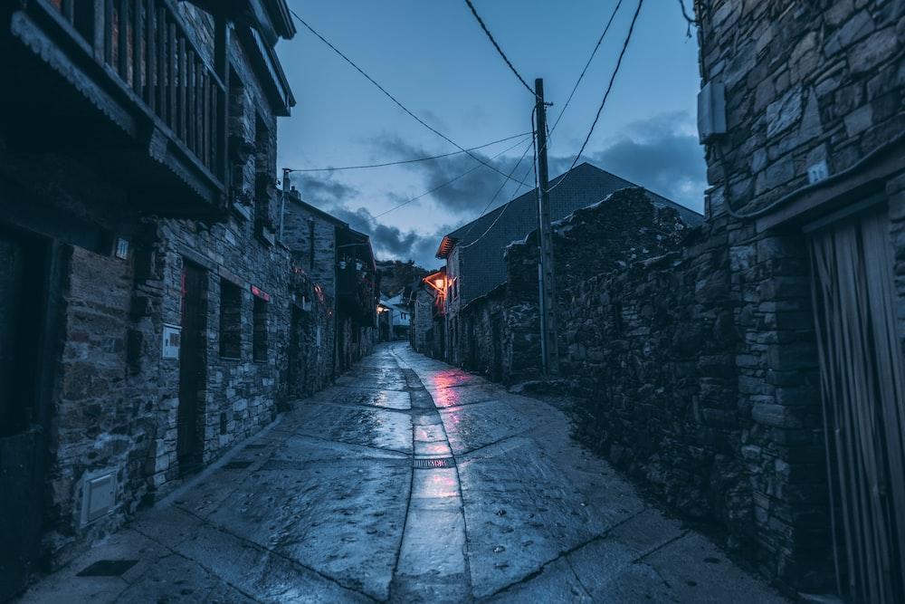 empty street between buildings during daytime
