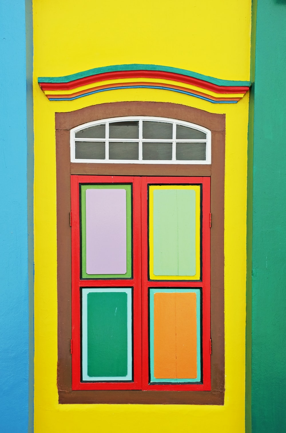 red blue and yellow wooden window