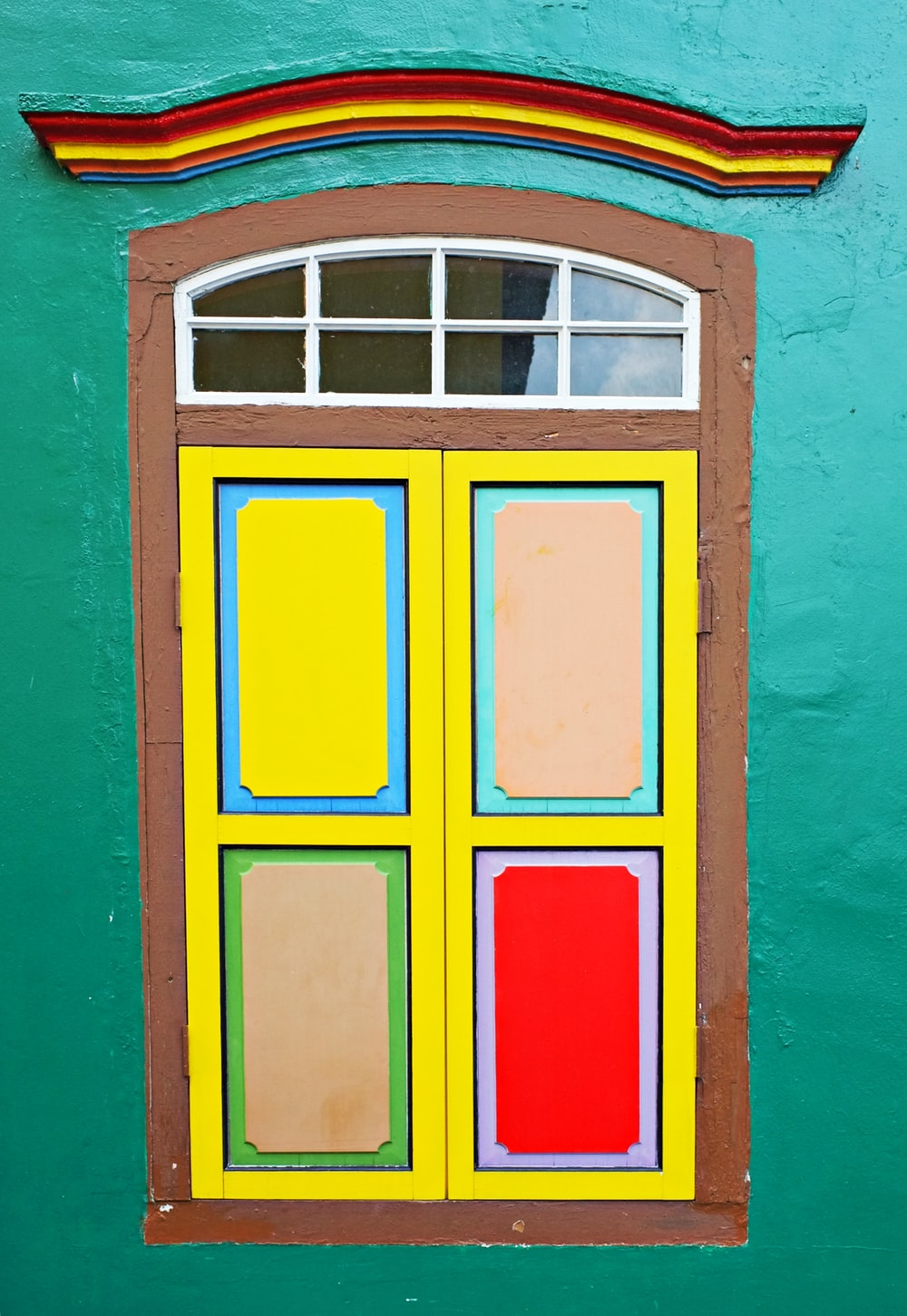 red yellow and green wooden window frame