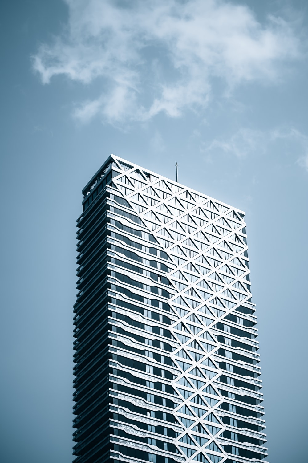 white and black building under blue sky during daytime