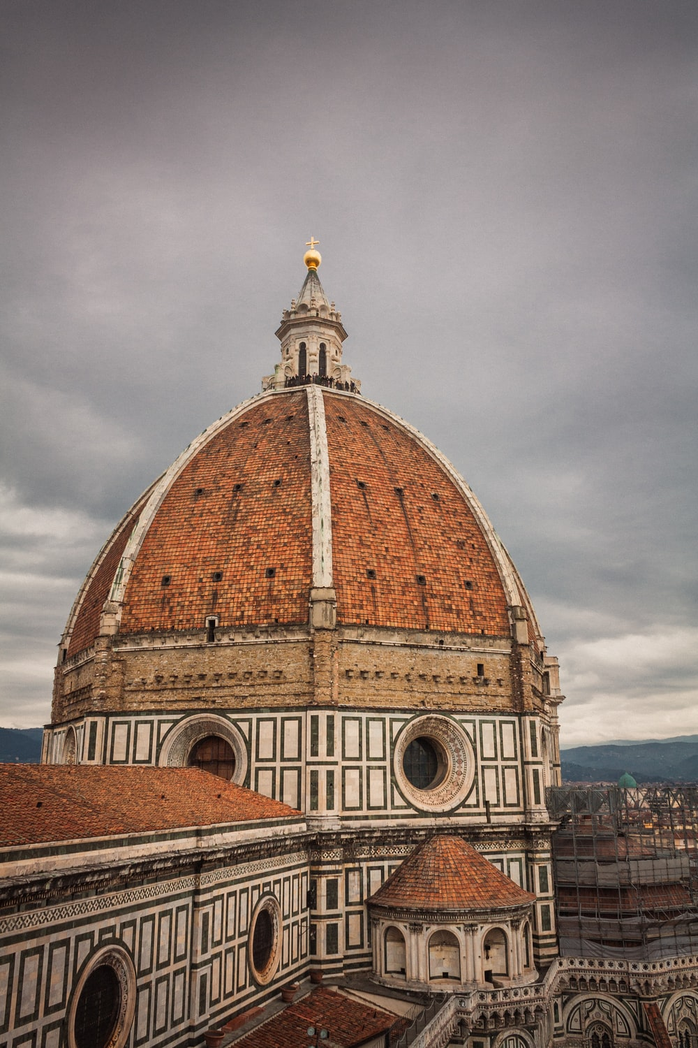brown dome building under gray clouds