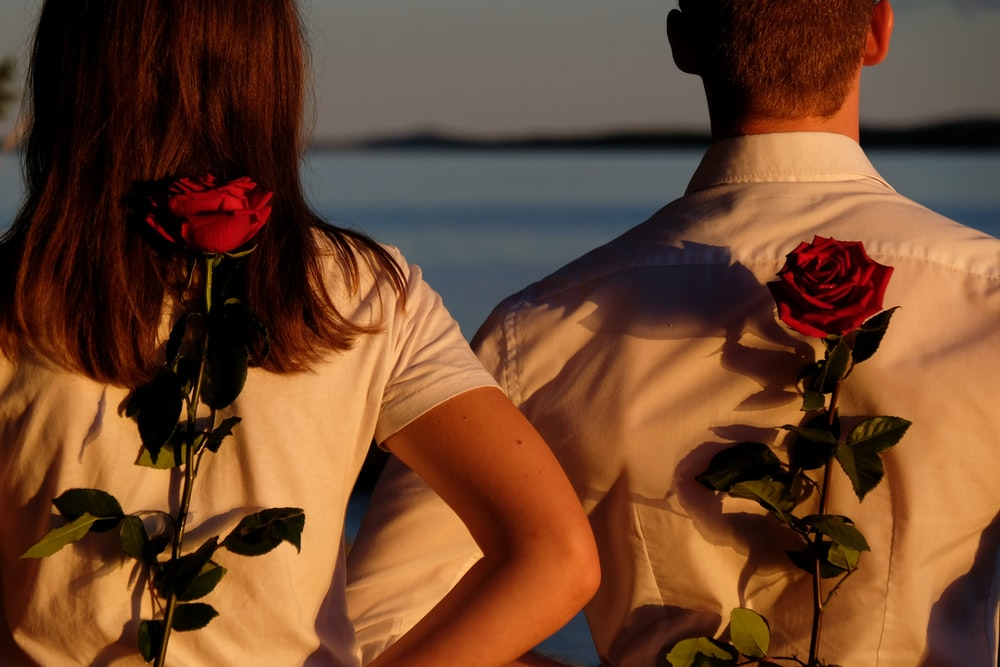 man in white shirt and woman in white shirt