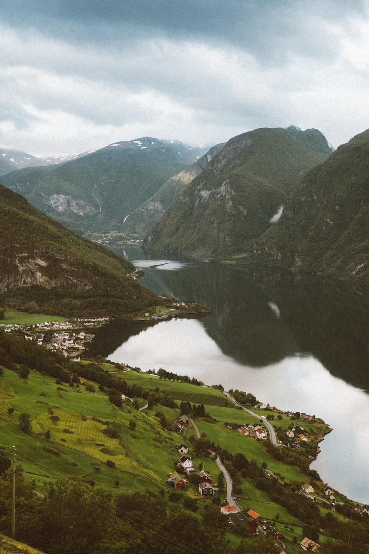 green mountains near lake during daytime