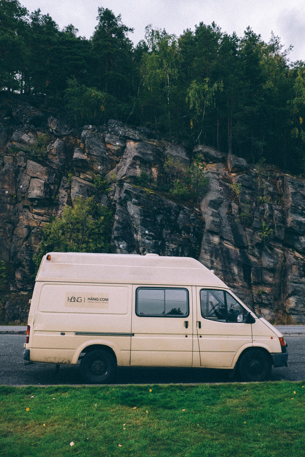 white van parked near mountain