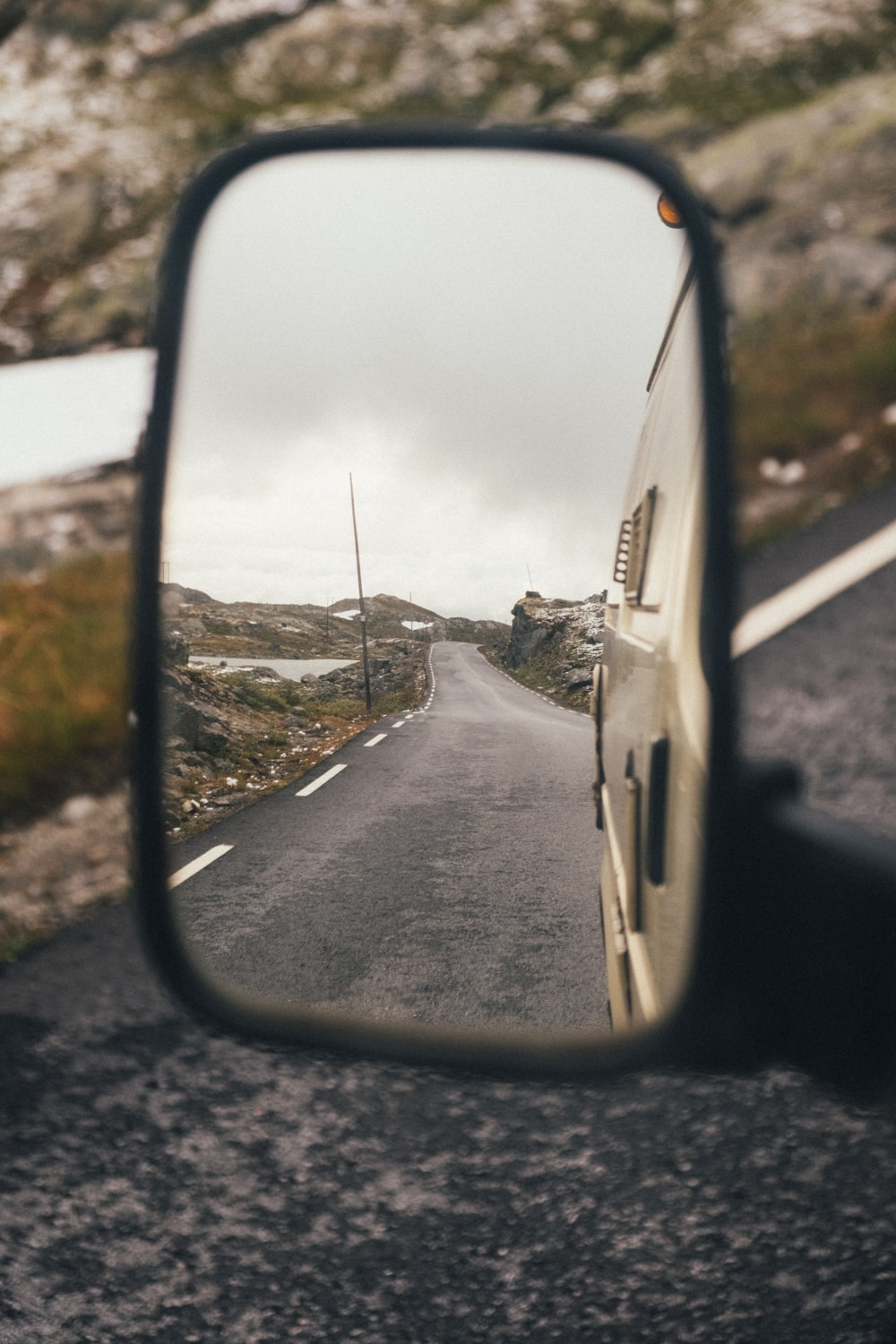 car side mirror showing white car