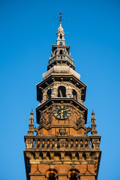 brown and white tower clock